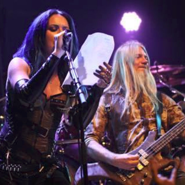 Alissa on stage with Marco Hietala during the Nightwish concert in Denver, the 28th of september, 2013