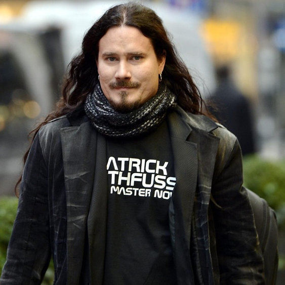 Tuomas wearing a Patrick Rothfuss is my master now tshirt