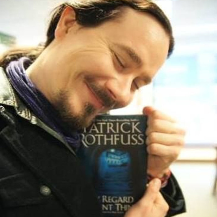 Tuomas with the novel The Slow Regard Of Silent Things from Rothfuss